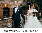 wedding couple near the castle...   Shutterstock . vector #746313517