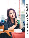 beautiful girl drinking coffee... | Shutterstock . vector #746314201