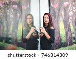 beautiful girl drinking coffee... | Shutterstock . vector #746314309