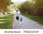 young mother with little son... | Shutterstock . vector #746321419