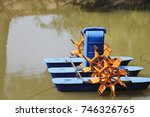 Small photo of Paddle wheel aerator in water
