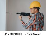 builder worker with pneumatic...   Shutterstock . vector #746331229