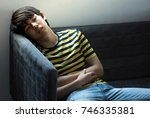 tired young boy sleeping on... | Shutterstock . vector #746335381