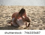 happy family playing on the... | Shutterstock . vector #746335687