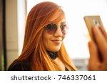 beautiful girl drinking coffee... | Shutterstock . vector #746337061