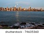 photo new york city skyline over hudson river - stock photo