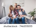 happy parents and kids sitting...   Shutterstock . vector #746355055