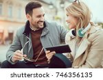 young attractive couple talking ... | Shutterstock . vector #746356135