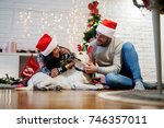 young happy couple with santa...   Shutterstock . vector #746357011