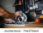 washing dishes. male hands in... | Shutterstock . vector #746370664