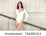young sexy girl in white body ... | Shutterstock . vector #746381311