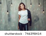 sexy woman in white t shirt and ... | Shutterstock . vector #746398414