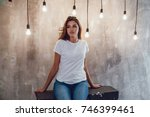 sexy woman in a white t shirt... | Shutterstock . vector #746399461