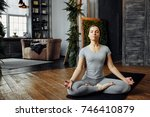 woman practicing home yoga. a... | Shutterstock . vector #746410879