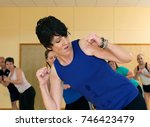 Small photo of aerobic exercise at gym