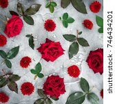 Stock photo floral pattern of red roses and chrysanthemums flowers with leaves on dark background flat lay 746434201