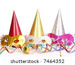 Three cone party hats, streamers and carnival masks over white background - stock photo