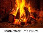 a fire burns in a fireplace ... | Shutterstock . vector #746440891