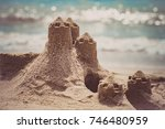 sand castle standing on the...