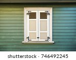 white window shutters and old... | Shutterstock . vector #746492245