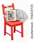 Small photo of An old retro accordion is waiting for the player.