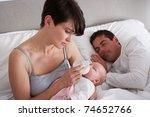Mother Feeding Newborn Baby In...