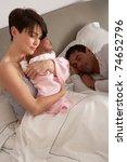 Mother Cuddling Newborn Baby In ...