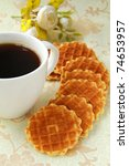 cup of black coffee and Belgian waffles for dessert - stock photo