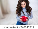 beautiful brunette woman with a ... | Shutterstock . vector #746549719