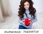 beautiful brunette woman with a ... | Shutterstock . vector #746549719