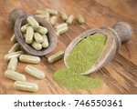 capsules with powder moringa ... | Shutterstock . vector #746550361