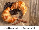 two fresh croissants and coffee ... | Shutterstock . vector #746560531