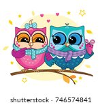 a couple of owls on a branch in ... | Shutterstock .eps vector #746574841