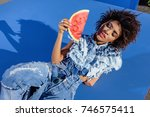 stylish african american girl... | Shutterstock . vector #746575411