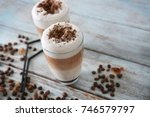 glasses with latte macchiato on ... | Shutterstock . vector #746579797