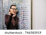 beautiful girl wearing glasses... | Shutterstock . vector #746583919