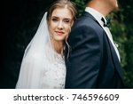young bride and groom in the... | Shutterstock . vector #746596609