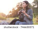 beautiful asian girl wearing a... | Shutterstock . vector #746630371