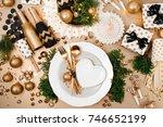 christmas table setting. gold...   Shutterstock . vector #746652199