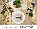 christmas table setting. gold... | Shutterstock . vector #746652301