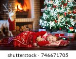 child sleeping at fire place on ... | Shutterstock . vector #746671705
