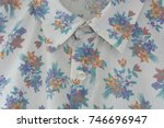 floral cloth frame close up. | Shutterstock . vector #746696947