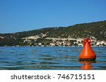 one red buoy and a sea | Shutterstock . vector #746715151