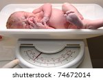 new born baby boy on a scale | Shutterstock . vector #74672014