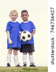 two diverse young soccer... | Shutterstock . vector #746736427