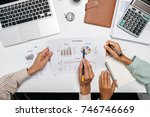 business team analyzing income... | Shutterstock . vector #746746669