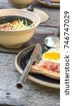 breakfast and wooden table... | Shutterstock . vector #746747029