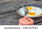breakfast and wooden table... | Shutterstock . vector #746747551