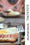 breakfast and wooden table... | Shutterstock . vector #746747575