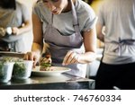 chef working and cooking in the ... | Shutterstock . vector #746760334